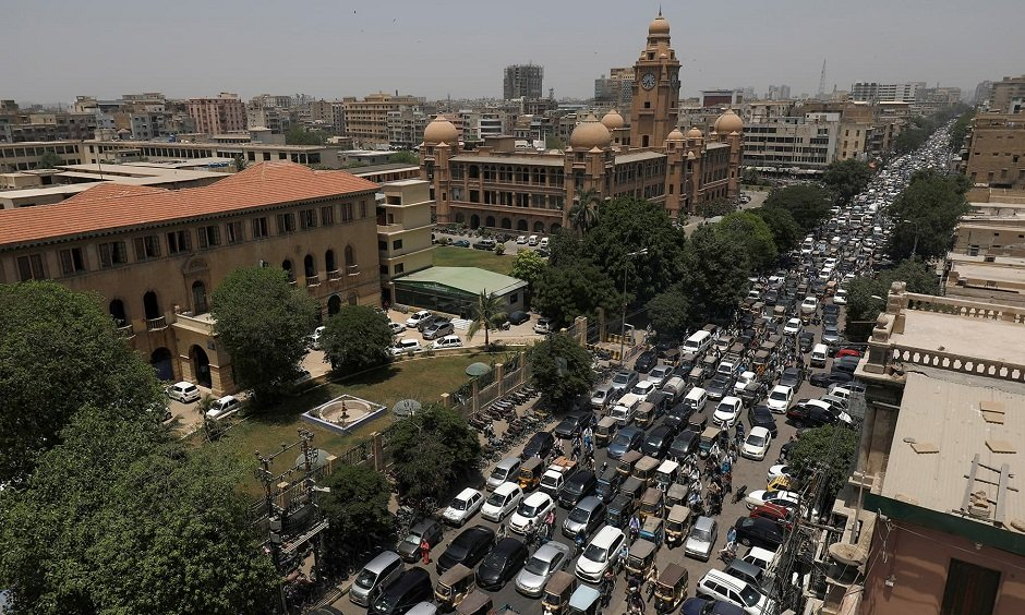 a general view of a road traffic and the karachi metropolitan corporation kmc building in the background after pakistan started easing the lockdown as the coronavirus disease covid 19 continues in karachi may 11 2020 reuters