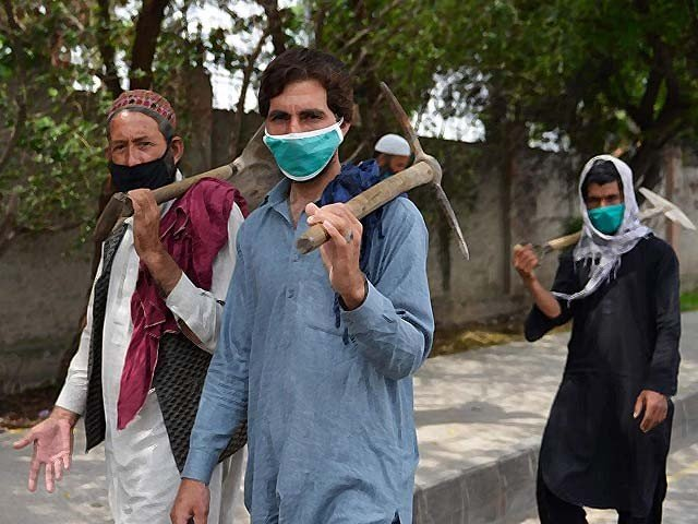 pakistani labourers walks along a street during a government imposed lockdown photo afp file