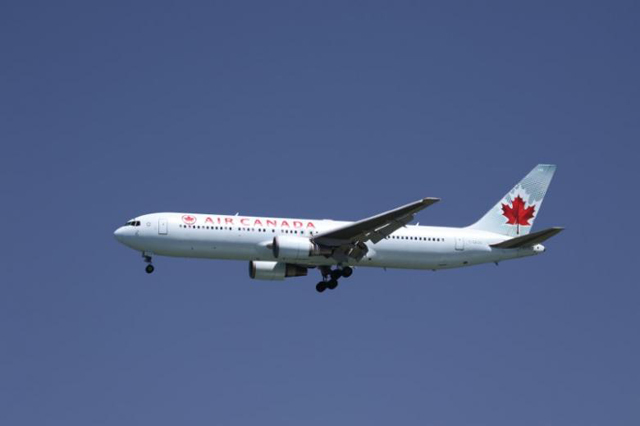 air canada to lay off half its workforce