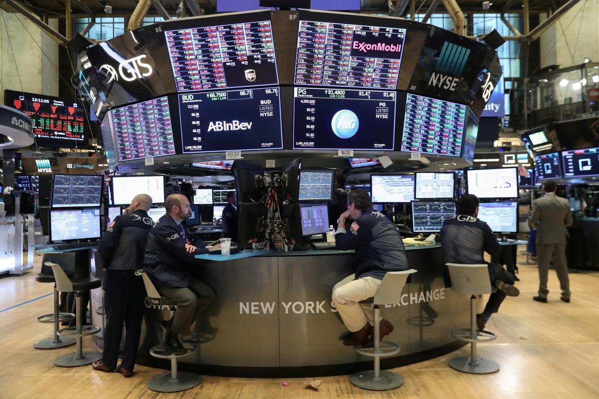 traders look at price monitors as they work on the floor at the new york stock exchange nyse in new york city photo reuters