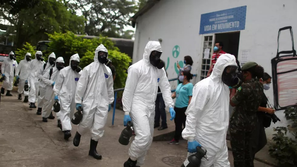brazilian army officers wearing protective gears arrive to disinfect the shelter stella maris complex for elderly people homeless and patients with mental disorders managed by the rio de janeiro city hall amid concerns of the spread of the coronavirus disease covid 19 in rio de janeiro brazil may 14 2020 photo reuters