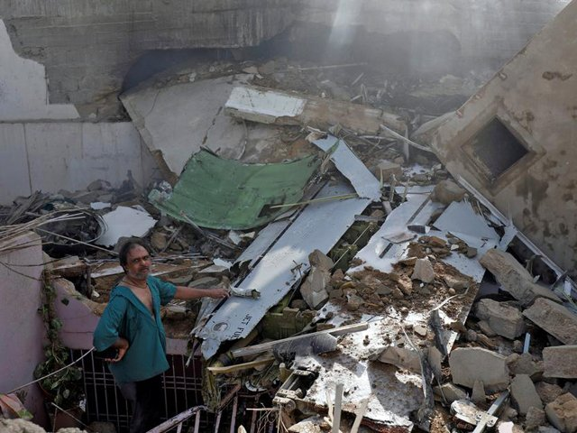 Residents, still shaken from the aftermath, share harrowing accounts of plane crash.  PHOTO: REUTERS