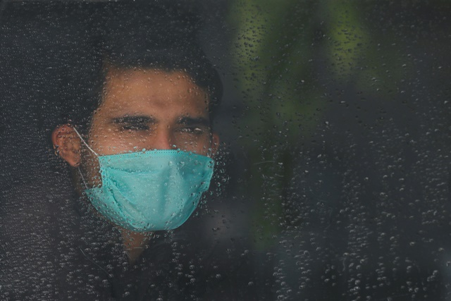 a-passenger-wearing-a-protective-mask-looks-out-from-a-train-window-as-he-returns-to-his-hometown-after-pakistan-started-easing-the-lockdown-restrictions-and-allowed-to-resume-passenger-trains-following-the-coronavirus-disease-covid-19-outbreak-in-peshawar-pakistan-may-20-2020-reuters-fayaz-aziz
