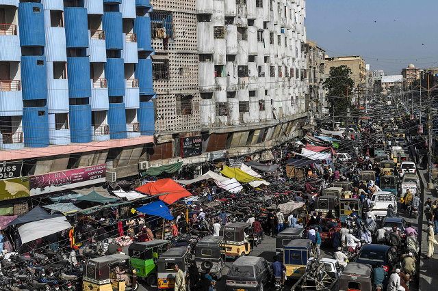 People gather around a market in Karachi for shopping, days before Eidul Fitr. PHOTO: AFP