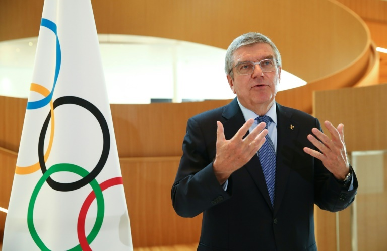 olympic chief bach consults with ioc members over virus fallout