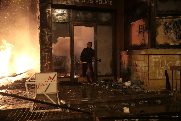a police building went up in flames in minnesota during protests photo afp