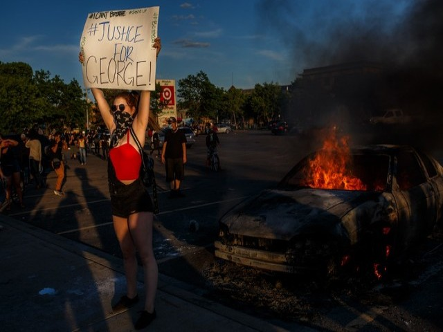a protester holds sign saying 039 justice for george 039 outside a target store near the third police precinct on may 28 2020 in minneapolis minnesota photo afp
