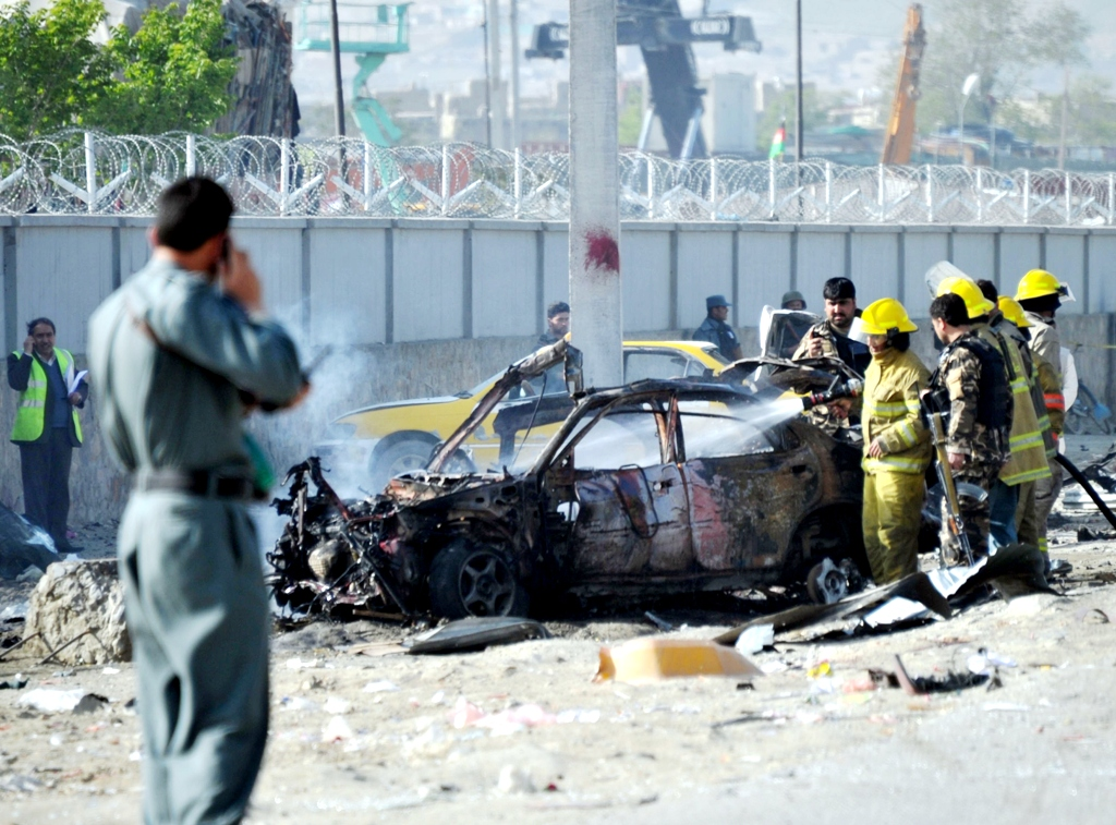afghan journalist and driver killed in blast