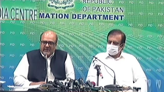 pm 039 s aide on accountability shahbzad akbar left and information minister shibli faraz address media in islamabad screengrab