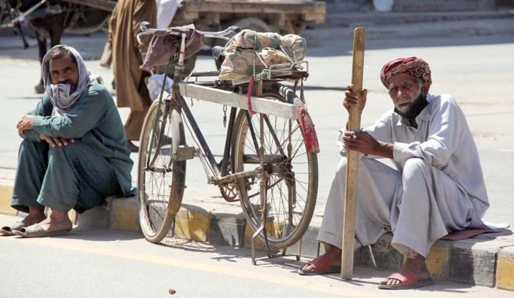 labourers-along-with-their-tools-sit-at-a-roadside-waiting-for-daily-job-in-sarghoda-punjab-june-9-2020-photo-app