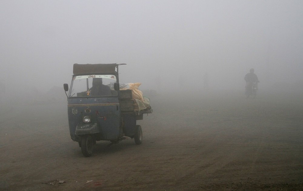 A man drives his rickshaw in heavy smog in Lahore. PHOTO: REUTERS