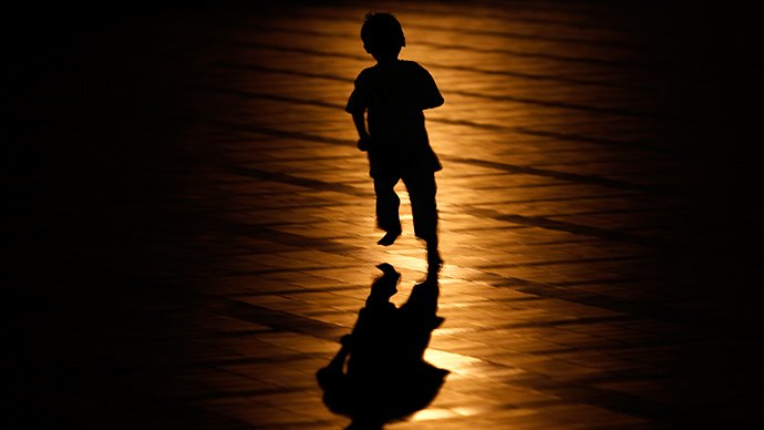 a child running in the shadows photo reuters
