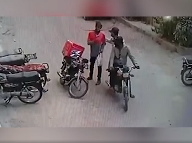 watch muggers return valuables to delivery boy as he breaks down in tears