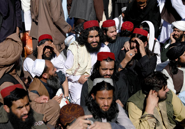 Newly freed Taliban prisoners sit at Pul-i-Charkhi prison, in Kabul, Afghanistan May 26, 2020. PHOTO: REUTERS