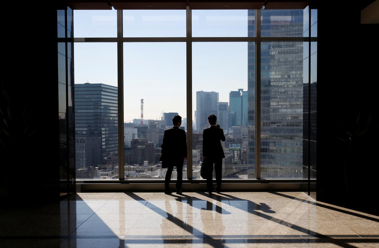 businessmen are seen inside a high rise office building photo reuters