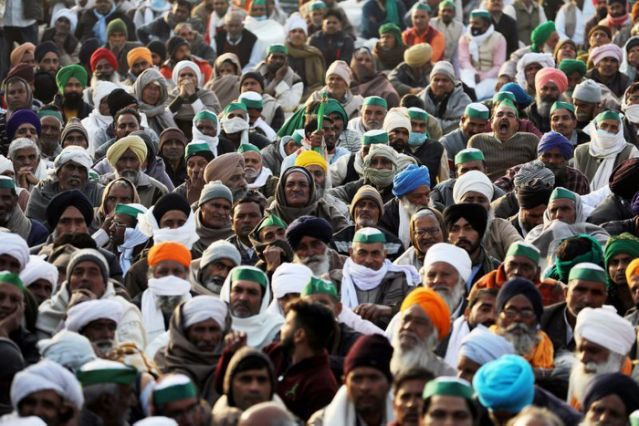 FILE PHOTO: Farmers take part in a protest against farm bills passed by India's parliament on the outskirts of Delhi, India, December 17, 2020. REUTERS