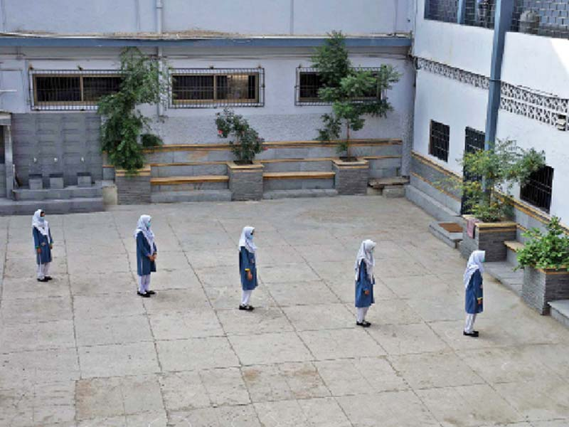 students queue up at safe distances as they enter school on the first day of classes after educational institutes were allowed to reopen since then however several institutes have seen covid 19 cases emerge photo online