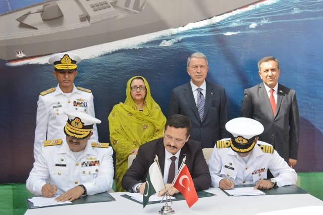 milestone certificate being signed between officials of karachi shipyard engineering works and m s asfat during milgem class corvette photo public relations directorate pakistan navy