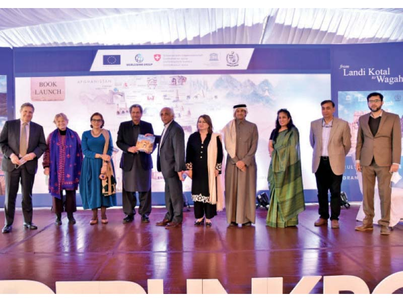 speakers at the book launch ceremony held at the pnca line up for a photo opportunity with the author salman rashid photo online