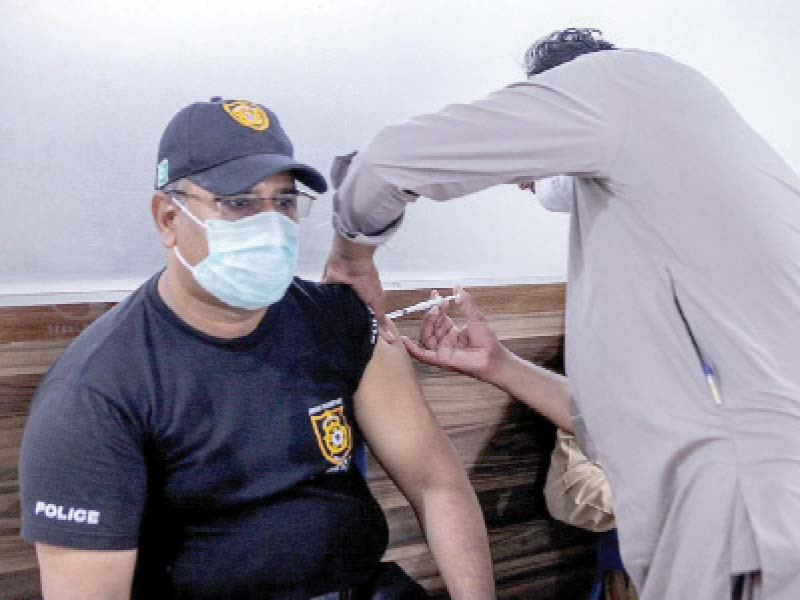 a police official receives an anti covid jab at the vaccination centre inaugurated at ssu on monday photo nni