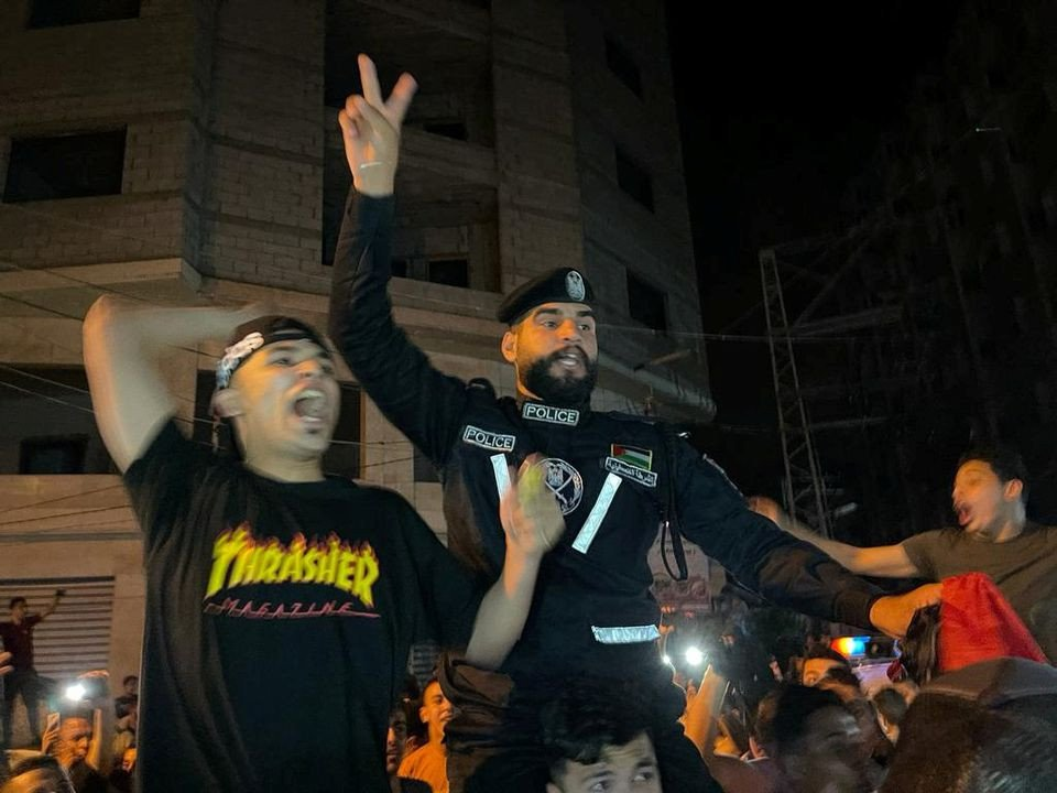 Palestinians celebrate in the streets following a ceasefire, in the southern Gaza Strip May 21, 2021. PHOTO: REUTERS