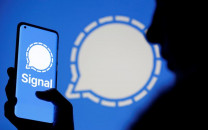 the signal messaging app logo is seen on a smartphone in front of the same displayed same logo in this illustration taken january 13 2021 photo reuters
