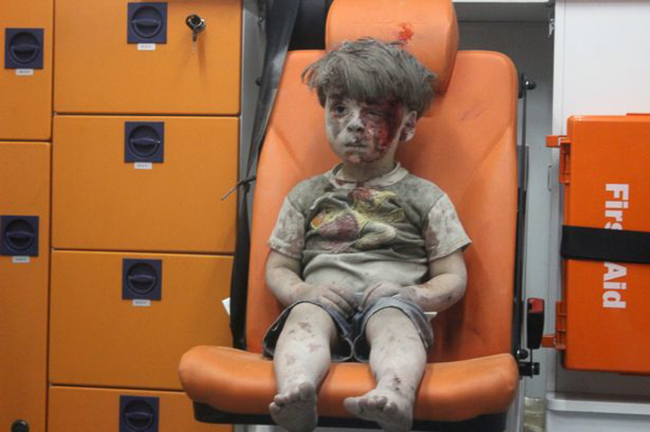 a picture of 5 year old omran daqneesh with bloodied face sits inside an ambulance after he was rescued following an airstrike in the rebel held al qaterji neighbourhood of aleppo photo reuters