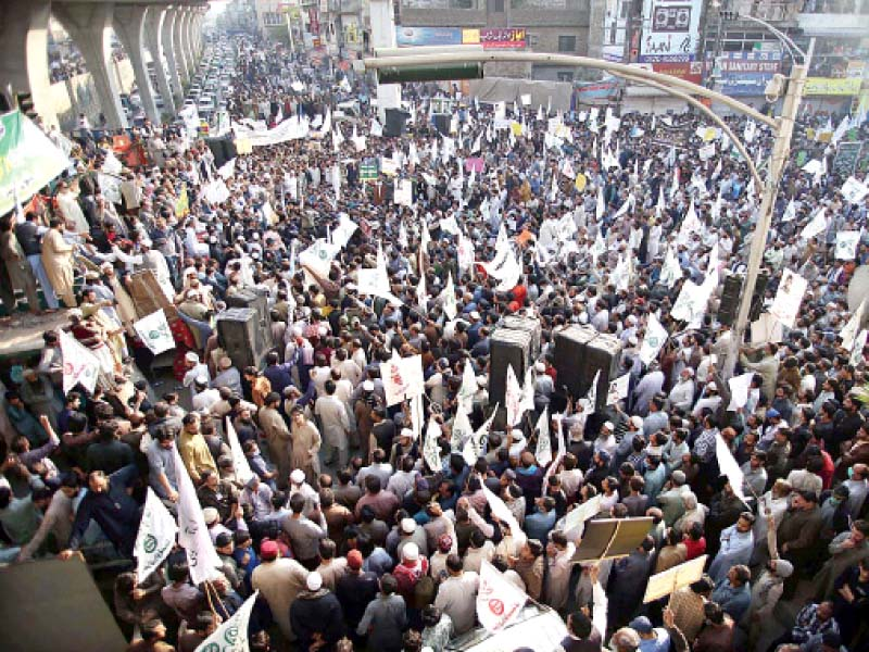 traders and shopkeepers hold a protest demonstration on murree road against the publication of blasphemous cartoon in france photo app
