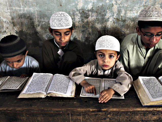 Students at a madrassa in Karachi on March 4, 2015. Religious schools in Pakistan are sometimes the only source of education for children. PHOTO: AP
