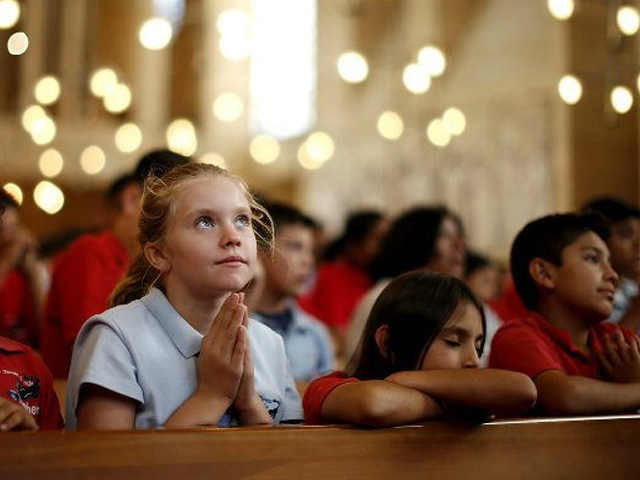 The spirituality taught in a Catholic school can help bind the gap between character education, academics and social interactions. PHOTO: REUTERS