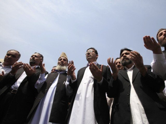 About 100 lawyer supporters of Osama bin Laden take part in a symbolic funeral prayer for the late al Qaeda leader in Peshawar May 4, 2011. PHOTO: REUTERS