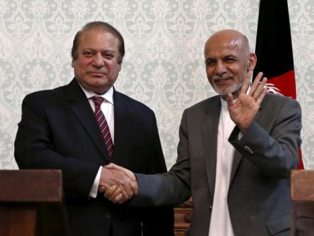 Afghan President Ashraf Ghani (R) shakes hands with Pakistani Prime Minister Nawaz Sharif after a news conference in Kabul, May 12, 2015. PHOTO: REUTERS