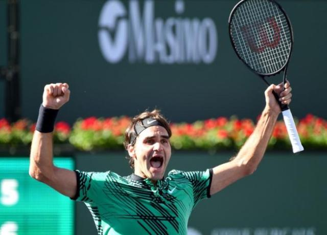 Mar 19, 2017; Indian Wells, CA, USA; Roger Federer (SUI) celebrates at match point as he defeated Stan Wawrinka (not pictured) 7-6, 6-4 in the men's final in the BNP Paribas Open at the Indian Wells Tennis Garden. PHOTO: USA TODAY Sports