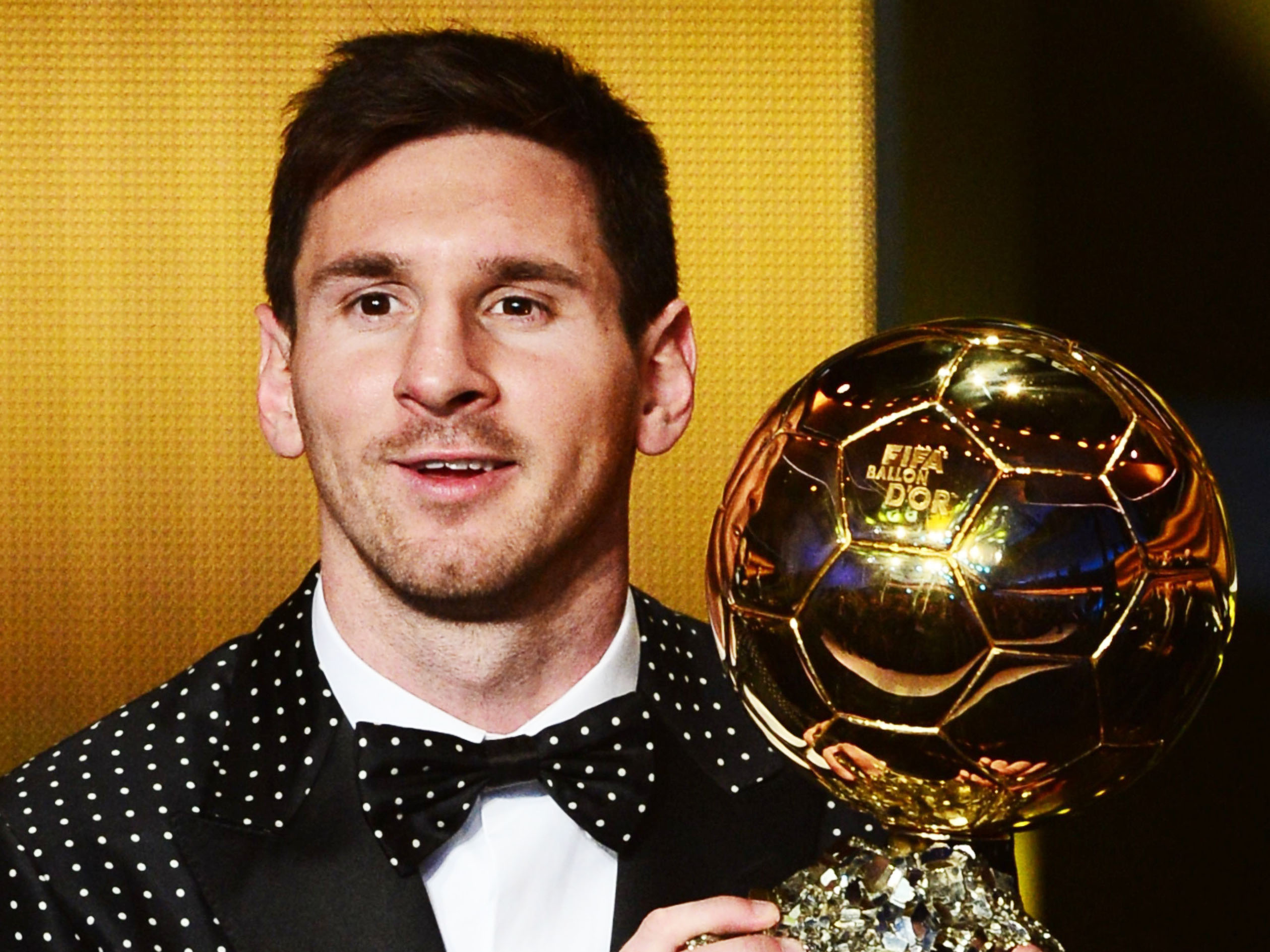 fifa ballon d 039 or award winner barcelona 039 s argentinian forward lionel messi poses with his trophy the fifa ballon d 039 or photo afp