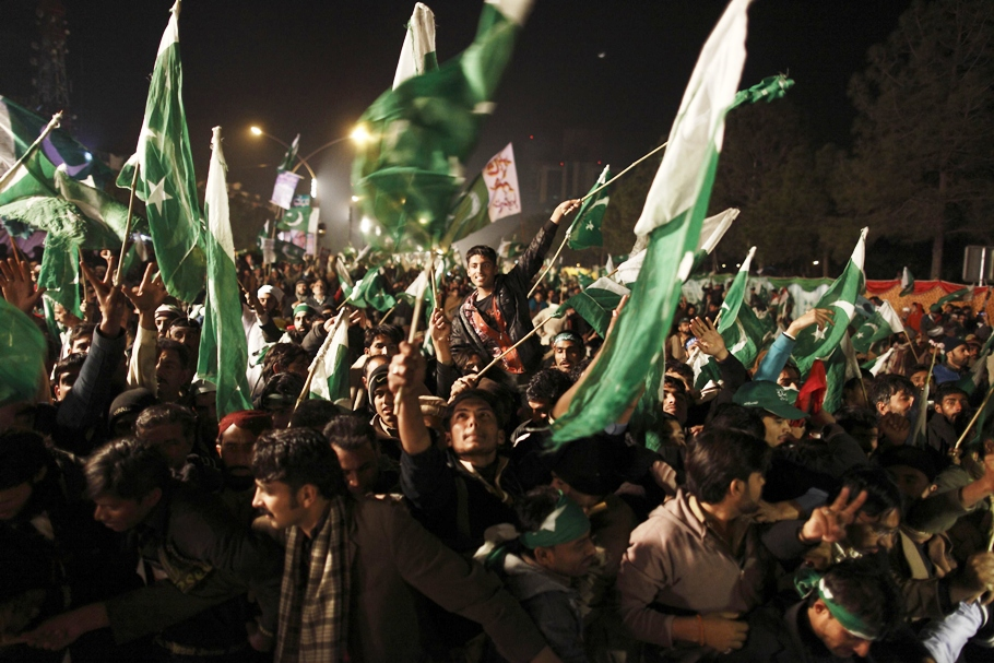 supporters of tahirul qadri wave pakistani flags during a protest in islamabad photo reuters