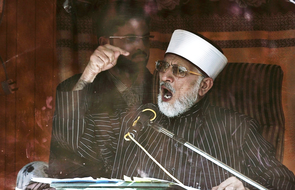 File photo of leader of Minhaj-ul-Quran International Tahirul Qadri addressing his supporters from behind the window of an armoured vehicle on the second day of protests in Islamabad January 15, 2013. PHOTO: REUTERS