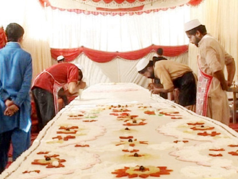 It was prepared with 6,000 eggs, 650 kilograms of desi ghee, 520 kg flour, 430 kg sugar and hundred of kilograms of apples, bananas, pineapple and dry fruit. PHOTO: EXPRESS