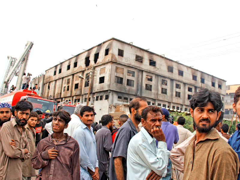 family members gathered outside the factory after the fire hoping for some good news file photo ayesha mir express