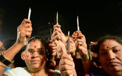 indian women hold knives as they pose for a photo during a function in mumbai photo afp
