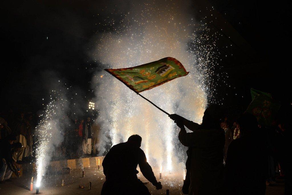 People celebrating on the eve of Eid Mildun Nabi in Lahore on Thursday. PHOTO: AFP