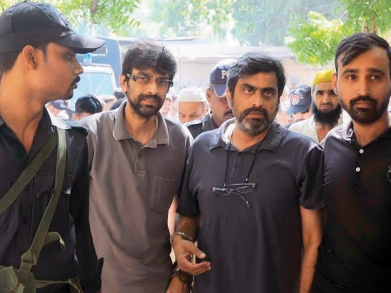 shahid bhaila left and arshad bhaila right owners of the ill fated factory in baldia returning from a court hearing photo file