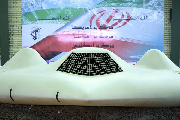 a us rq 170 unmanned spy plane displayed in front of a iranian flag with persian script that reads quot down with the us down with israel and down with britain quot at an unknown location in undated picture received december 8 2011 photo reuters file