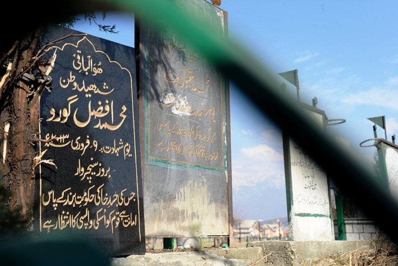 A tomb stone for Kashmiri separatist,  Afzal Guru (L),  is seen at the Martyrs Graveyard in Srinagar on February 12, 2013. PHOTO: AFP