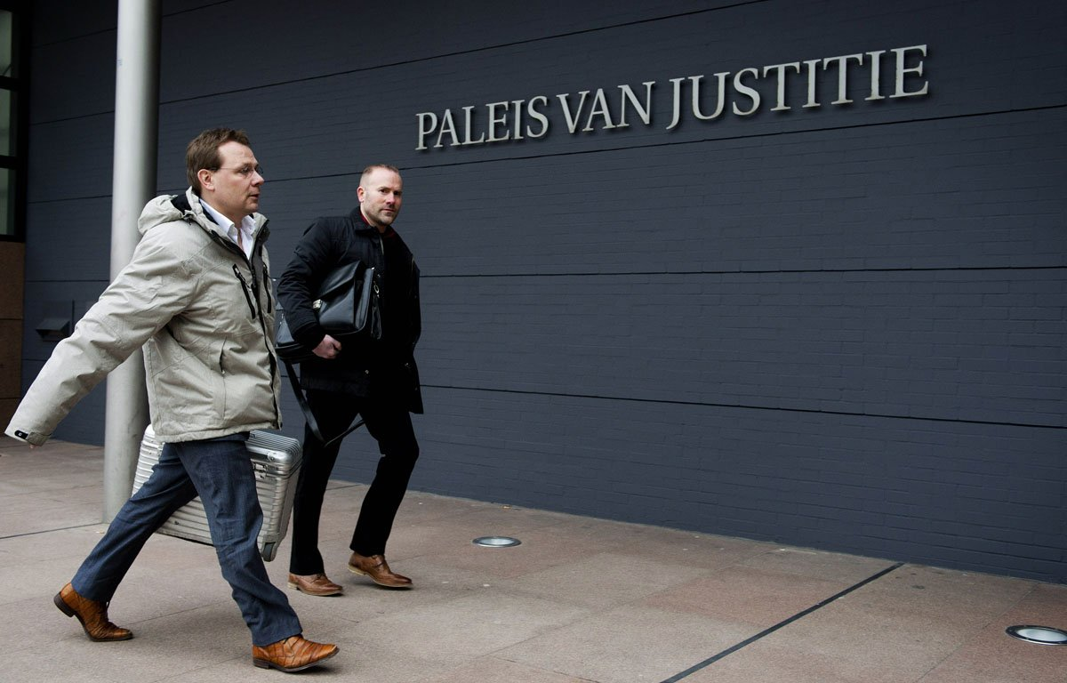lawyer of pakistani dutch national sabir khan andre seebregts l arrives in the courtroom of the hague on february 12 2013 photo afp