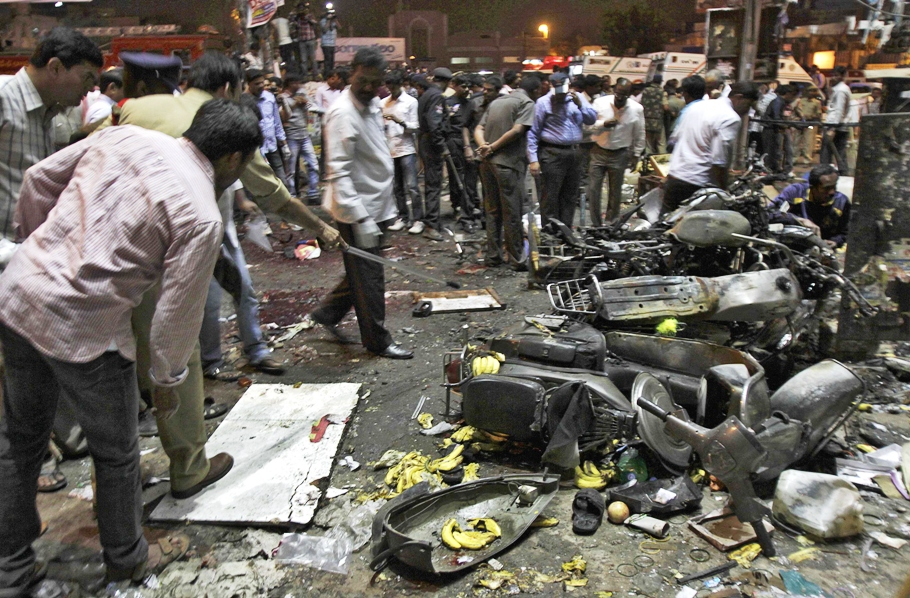police examine the site of an explosion at dilsukh nagar in the southern indian city of hyderabad february 21 2013 photo reuters