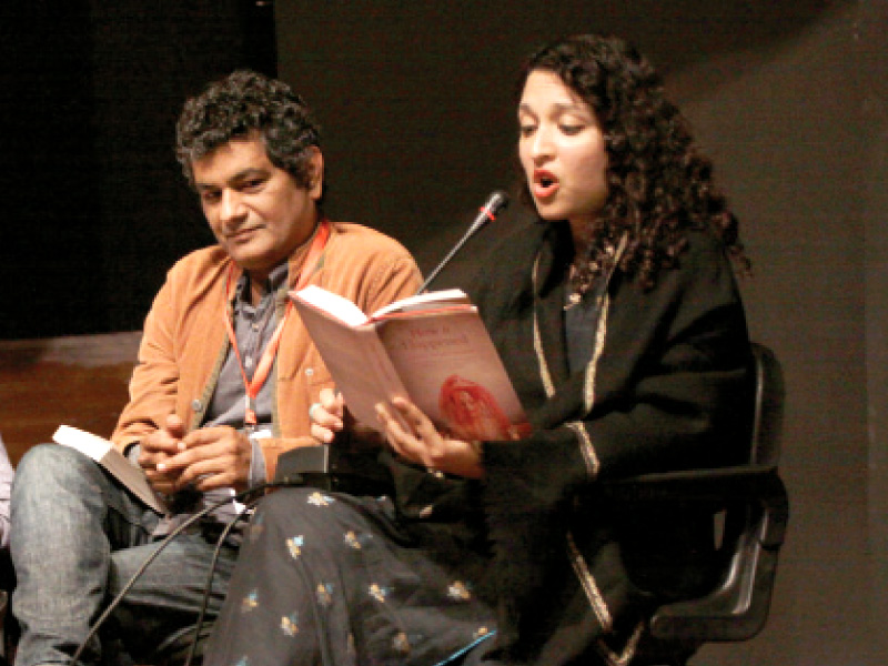 Shazaf Fatima reads from her book as Muhammad Hanif looks on.