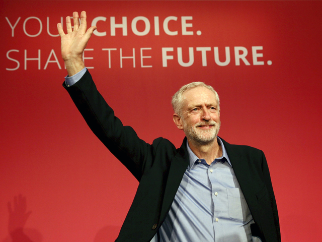 the new leader of britain 039 s opposition labour party jeremy corbyn waves after making his inaugural speech at the queen elizabeth centre in central london september 12 2015 photo reuters