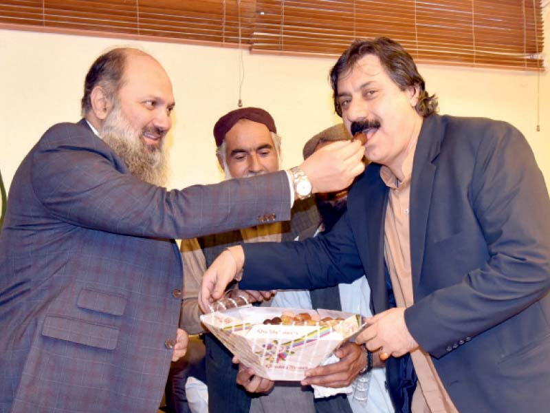 balochistan and khyber pakhtunkhwa chief ministers jam kamal and mahmood khan celebrate the senate election victory with party members photo express
