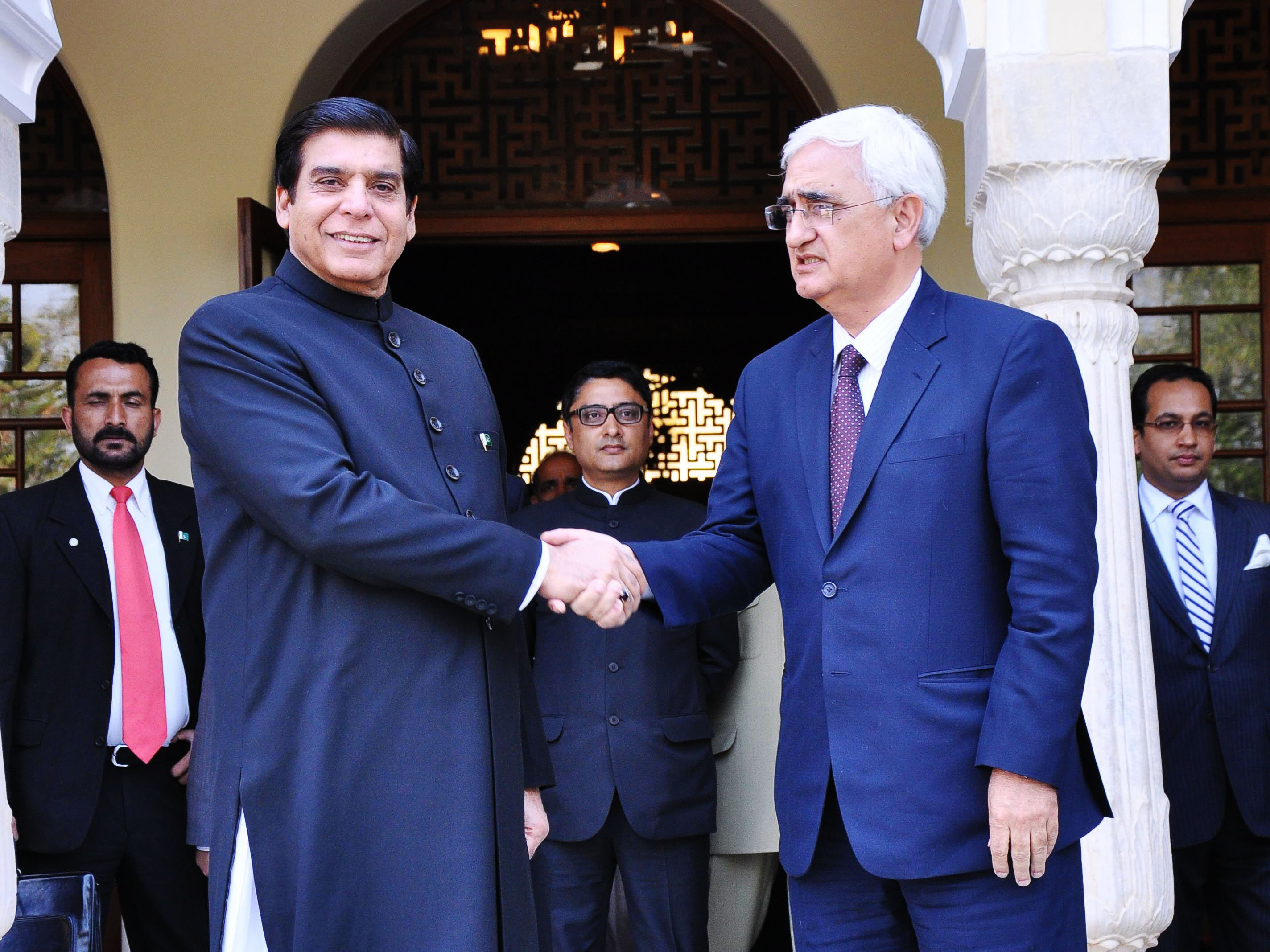 prime minister raja pervez ashraf r shakes hands with indian foreign minister salman khurshid at a hotel in jaipur march 9 2013 photo afp