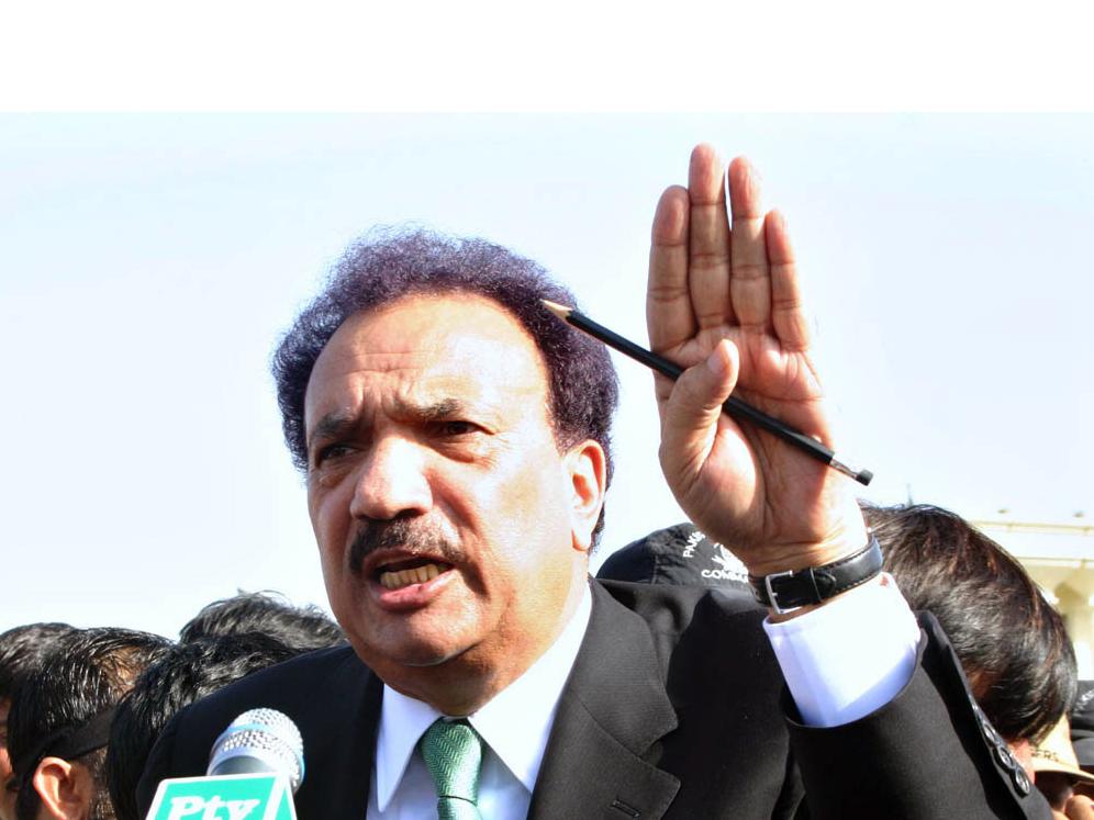 file photo of interior minister rehman malik photo app file
